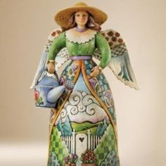 I love all that is Jim Shore   Heartwood Creek - I have the teapot angel of hospitality.