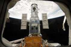 May 13, 2009 – The Hubble Space Telescope is captured by the Space Shuttle Atlantis. (NASA)