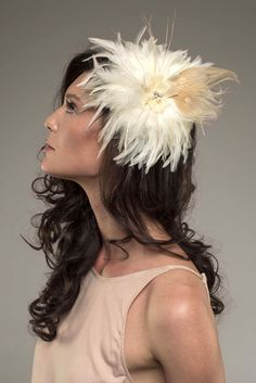 ANA – Ivory hackle and bleached peacock bridal fascinator. Sold from The Feathered Head's Collection.