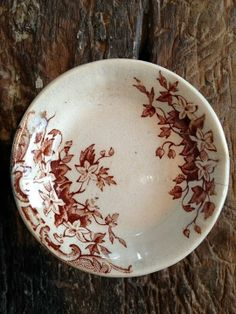 brown transferware butter pat.