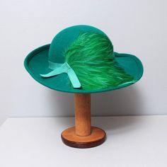 1970s Hat - Emerald Green Wool Large Brim Hat with Feather. $40.00, via Etsy.