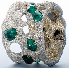 Cindy Chao. This bracelet belongs to her Masterpiece series of 8 and it is set with 11 sugarloaf emeralds and 2000 diamonds. She claims this particular piece was inspired by Spanish Arquitect Gaudi. Via Collecting Fine Jewels.