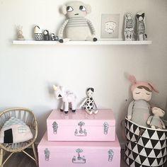 Shared monochrome kids room pink metal trunks IKEA RIBBA ledges
