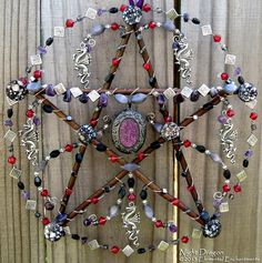 Night Dragon. Willow branches, wire, metal beads, glass beads, amethyst beads, hematite beads, shell beads, metal dragon charms, and purple pendant. - KM Fields' Elemental Enchantments
