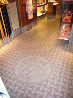 Hermes showroom in Venice Italy with Winckelmans custom tile floor and logo