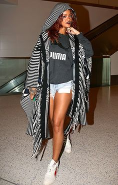 Landing back at LAX Airport in Los Angeles after a trip to Hawaii April 28, Rihanna turned heads in a sexy but casual travel outfit.
