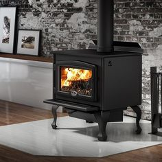 Osburn 2000 Wood Stove with Blower — Hearth, Stove & Patio Wood Stove Hearth, Stove Fireplace, Fireplace Ideas, Rustic Sunroom, Log Home Living, Living Room, Refractory Brick, Cast Iron Stove, Vintage Stoves