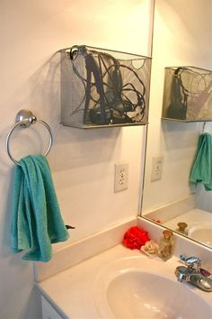 Bathroom appliance storage// inspiration...wire filing bin to place under sink for hot hair tools