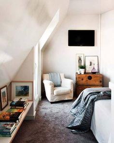 Such an unassuming yet wonderful attic bedroom.