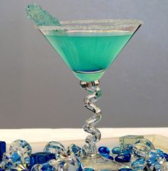 Hpnotiq Breeze -  2 ounces Hpnotiq Liqueur, 1 ounce coconut rum, Splash of pineapple juice, Ice, Sugar for the rim of glass - Garnish: Lime, rock candy, pineapple, anything (optional)