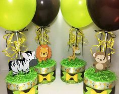 Request a custom diaper cake centerpiece to fit your baby shower theme. and 3 tier diaper cakes as well as other custom baby shower decorations. Safari Centerpieces, Baby Shower Table Centerpieces, Baby Shower Decorations, Lion King Baby Shower, Baby Boy Shower, Jungle Baby Showers, Baby Shower Cakes, Baby Shower Themes, Baby Cakes