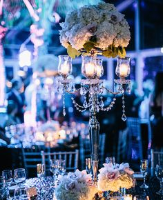 Black & silver tables, silver chairs, silver candlesticks, white flowers. & blue lighting! Boom! // Featured: The Knot Blog