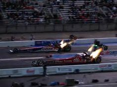 Nitro Top Fuel cars at dusk
