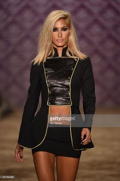 Cagla Sikel walks the runway at the Hakan Akkaya show during Mercedes Benz Fashion Week Istanbul SS15 at Antrepo 3 on October 17, 2014 in Istanbul, Turkey.