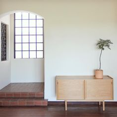 Sliding Doors | Our NK Purist Credenza in a solitary moment.