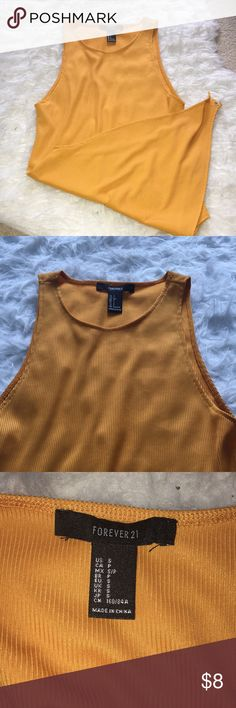 Mustard BodySuit Never worn before! Super cute to pair with jeans and sneakers! Has somewhat of a silky texture. Forever 21 Tops