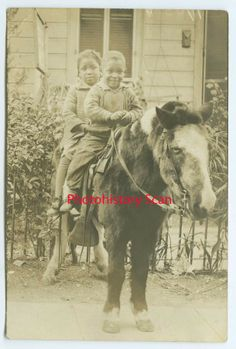 black children on pony
