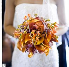 I like how this bouquet uses the elegant flowers, but the other added elements (branches, berries, etc.) make it feel more rustic/country