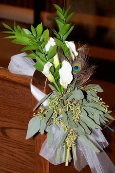 Peacock arrangement photo and design by Tamra Turner owner of Sunshine wedding company and Tamra Turner photography.