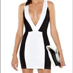 FLASH SALE Black and white V neck dress Runs small. Body-con. Sexy for any night life occasion. Nasty Gal Dresses