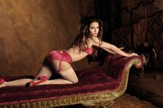 An appreciation of bottoms framed by garters.