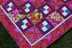 "Wrap yourself in beautiful florals! This lovely quilt is made using bright floral prints by fabric designer Kaffe Fassett. It is rich in color and will brighten anyone's day!  This quilt measures 50"" x 57"". The perfect size for a lap quilt for movie night or to add a bit of warmth when napping."