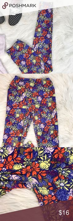 Lularoe Buttery Soft Floral Leggings OS These buttery soft leggings are the perfect print and colors for spring! Rock these with your favorite color Irma or a Chambray Tunic. One night I drank several glasses of wine and decided I wanted a few pairs... 18 pairs later I have more leggings than I'm able to wear since I work a corporate job and leggings are frowned upon. These are gently worn. OS. Have tiny pin holes in butt but not noticeable when worn with something long. LuLaRoe Pants…