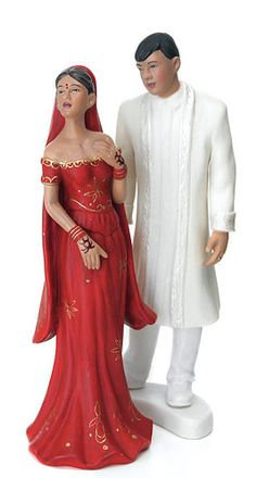 """Hand Painted Indian Bride & Groom Porcelain Cake Topper Groom Size: 5.5""""H Bride Size: 5""""H When you get married, it's more than just a union of two people, rather it's the unification of two families, their cultural heritages, the ancestors of each merging together in a new and hopeful family, that will carry those traditions on into the next generation. As such, it's important to portray that cultural heritage at the actual ceremony, as a way of showing your commitment to your…"""