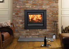 In this article we cover all you need to know about wood burning stove installation. From Defra approved wood burners, efficiency, to the cost of installing a wood burning stove. Wood Burning Stove Corner, Wood Burning Fires, Inset Fireplace, Stove Fireplace, Fireplace Inserts, Insert Stove, Dark Wood Desk, Stove Installation, Slate Hearth