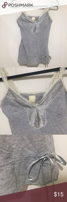 Hollister grey tank Grey tank with silver satin trim around neckline. Ivory colored Lace straps. Has a silky silver ribbon to tighten bottom of tank (see last photo). Hollister Tops Tank Tops