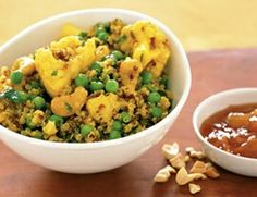 Curry quinoa cauliflower * 1 cup quinoa, rinsed   * 1 cup frozen peas   * 2 Tbs. peanut oil   * ½ tsp. whole fennel seeds   * ½ tsp. whole cumin seeds   * 4 tsp. mild curry powder   * 1 cup low-sodium vegetable broth   * ⅛ tsp. turmeric   * 1 medium head cauliflower (about 1 ½ lb.), trimmed and cut into small florets   * ⅓ cup low-fat plain yogurt   * ¾ cup whole roasted, salted cashews   * ¼ cup chopped cilantro   * mango chutney, for serving   * Bring large pot of water to a boil. Add…