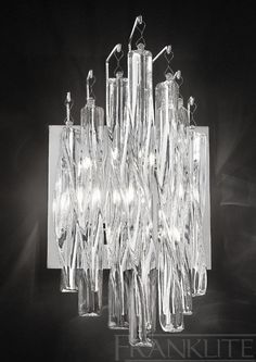 The Franklite Lighting Glacial Wall Light has twisted clear glass rods suspended from a Chrome finish back plate. The Glacial Wall Light is available from Luxury Lighting - approved Franklite retailers. Flush Lighting, Dar Lighting, Luxury Lighting, Lighting Store, Wall Spotlights, Wall Lights, Ceiling Lights, Crystal Wall, Exterior Lighting