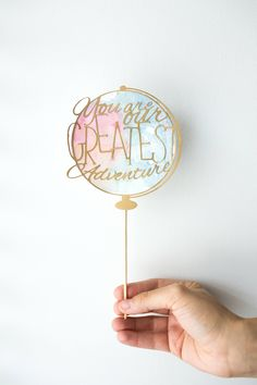 You Are Our Greatest Adventure Cake Topper, World Theme Baby Shower, Watercolor Travel Theme Baby Shower Decor, Hello World Party Decor by Katrinamakes on Etsy https://www.etsy.com/listing/594564055/you-are-our-greatest-adventure-cake