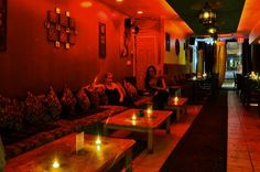 hookah lounge - great idea if you entertain a lot - banquette seating and multiple coffee tables