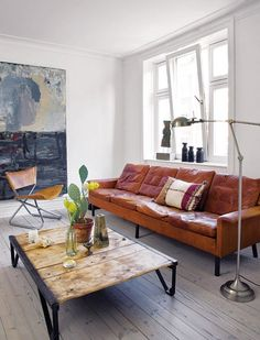 cognac leather, cactus, white walls, wood, terracotta, wrought iron.