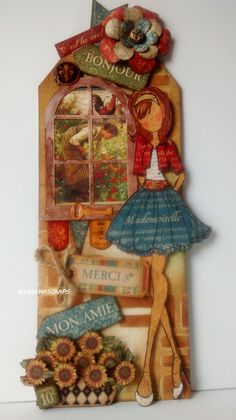 """The Tourist"" (totally over-dressed for the French country tour)...I used the G45 French Country paper collection and chipboard pieces. The Julie Nutting doll's outfit was paper pieced with the solids and patterns paper that matches the collection. The tag is from the Julie Nutting tag pad that I stenciled, inked then clear embossed."