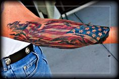 "FlagAmerica ! by LITOS -  	American Flag Tattoo Sleeve done on a long time FireFighter Client.  	Done by LITOS with ""THUNDERCAT "" ROT"