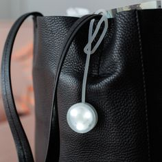Kleines LED-Licht zur Befestigung an Handtaschen.