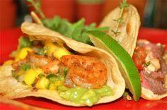 Blackened shrimp taco with guacamole and mango ginger salsa.