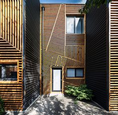 When Pominchuk Architects were designing these townhouses in Kharkiv, Ukraine, they decided to use wooden strips arranged in a geometric design to create a unique facade.