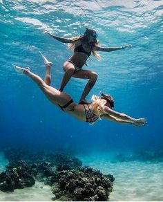 Girl surfing on girl underwater