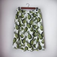 """Pineapple skirt New with tags!! 100% rayon. Perfect for vacations, beach, luau, and all other fun summer occasions! Waist laid flat just less than 16"""". Length 24"""". Section of elastic on back of waistband.  Bundle for best deals! Hundreds of items available for discounted bundles! You can get lots of items for a low price and one shipping fee!  Follow on IG: @the.junk.drawer Living Doll Skirts"""
