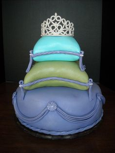 "Artist says ""I made this for my daughters 21st bday.  This is my first time carving pillow cakes and also my first tiara and drapings.  Lots of firsts f..."
