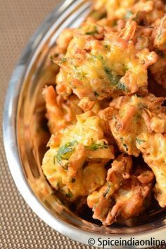 Description:Pakoras are a favorite in India. They are simple and fast, yet delicious, these Indian battered and deep fried vegetable bits are great served by themselves as a snack or as an ...