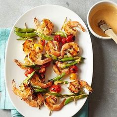Spicy Shrimp and Sugar Snap Pea Kabobs From Better Homes and Gardens, sounds good!