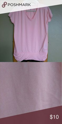 Champion exercise top Pink exercise top with barely noticeable spot shown in picture have to look hard to find it on front left of top. Champion Tops Tees - Short Sleeve