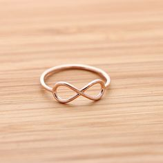 simple INFINITY ring, in pinkgold $15