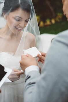 The bride excitedly exchanges vows with the groom. | Button Up Photography