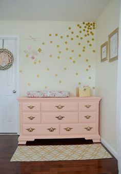 Coral Painted Vintage Dresser/Changing Table + Gold Wall Decals = Nursery Love!