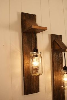 This unique pair of mason jar light fixtures are handcrafted using reclaimed wood. Each piece of wood is inspected and hand selected for each fixture we create. The vintage hardwood mounts, lights in